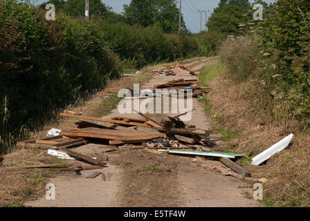 Fly-tipping of rubbish on a Norfolk country lane in UK - Stock Image