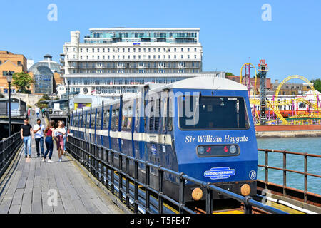 Southend on Sea landmark parkinn Palace hotel & railway people walking on pier beside train seafront seaside resort town of Southend Essex England UK - Stock Image