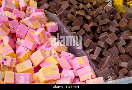 Selection of fudges for sale in a pick and mix counter where people select their own favourite penny mixtures from - Stock Image