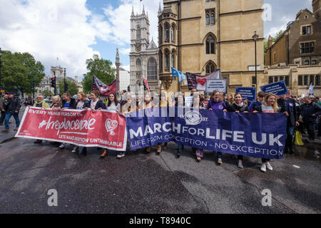 London, UK. 11th May 2019. The March for Life UK, a largely Catholic event, marches past pro-life protesters on Victoria St. Based on extreme right protests in the USA opposed to abortion they aim to raise awareness of the hurt and damage it causes and bring to an end what they call the greatest violation to human rights in history. Pro-choice opponents say they deny women basic rights, back harassment of women and oppose contraception, sex education and IVF fertility treatment. Peter Marshall/Alamy Live News - Stock Image