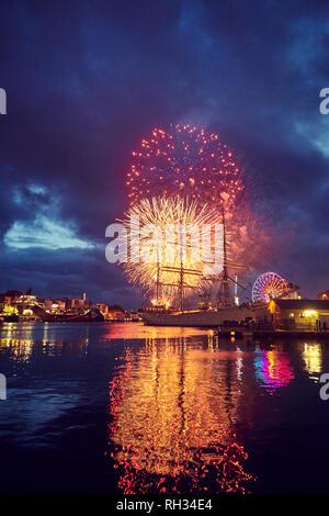 Fireworks over sea - Stock Image