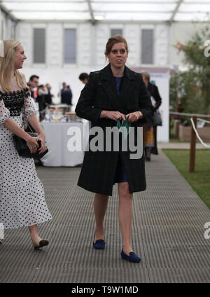 Princess Beatrice of York with her friend Alice Naylor-Leyland as they look at a display during their visit to the RHS Chelsea Flower Show at the Royal Hospital Chelsea, London. - Stock Image