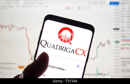 MONTREAL, CANADA - APRIL 26, 2019: QuadrigaCX cryptocurrency exchange logo and application on Android Samsung Galaxy s9 Plus screen in a hand over a l - Stock Image