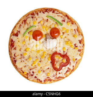 A pizza with the toppings looking like a face - Stock Image