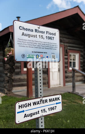 Marker in front of the Gould Cabin showing the high water mark from the 1967 Chena River flood Griffin Park in downtown Fairbanks, Alaska. - Stock Image