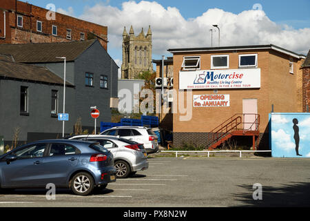 Oak Street car park and Christ Church tower in Crewe town centre UK - Stock Image
