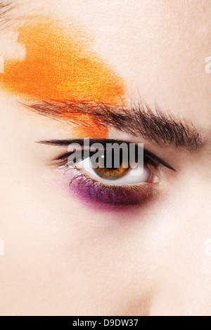 Close up of female eye with bright makeup - Stock Image