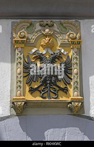 Double eagle, coat of arms on a house wall, old town, Wangen, Allgäu, Baden-Württemberg, Germany - Stock Image