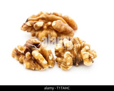 Three Walnut halves of Walnuts shelled nuts isolated on a white background. England UK Britain - Stock Image
