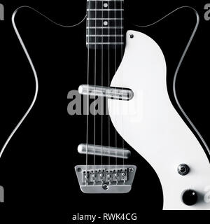 Close-up of a black and white electric guitar - Stock Image