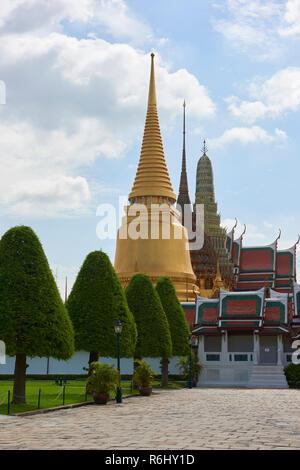 Three large pagodas inside the Grand Palace in Bangkok, Thailand. - Stock Image