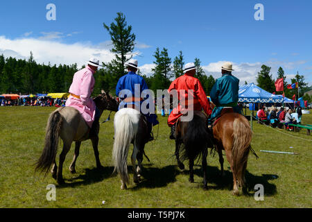Naadam Festival in Khatgal, Mongolia. Young horseriders in their colourful garments - Stock Image