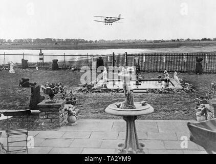 A plane (tail number D-BAHZ) on approach at the Croydon Airport in London. - Stock Image