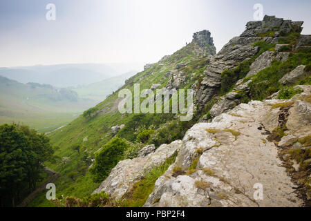Walkers at the Valley of Rocks, Lynton, North Devon, looking inland, on the South West Coast Path. - Stock Image