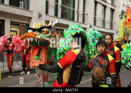 London, UK. 1st January, 2019. Performers from the london Chinatown CHinese Association seen ahead of the New Years parde at Berkley Square. About 8,000 performers representing the London boroughs and over 20 countries from across the globe take part on the annual New Years Parade on the street of London. The parade run from Green Park Tube station to Parliament Square. Photo credit:  David Mbiyu/Alamy New Live - Stock Image