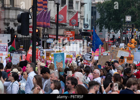 London, United Kingdom. 13 July 2018. The 'Drag Protest Parade' and the 'Womens March' march through central London protesting against the US Presidents UK visit. Credit: Peter Manning/Alamy Live News - Stock Image