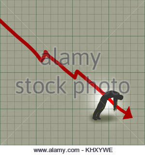 Businessman impaled by decreasing line graph - Stock Image