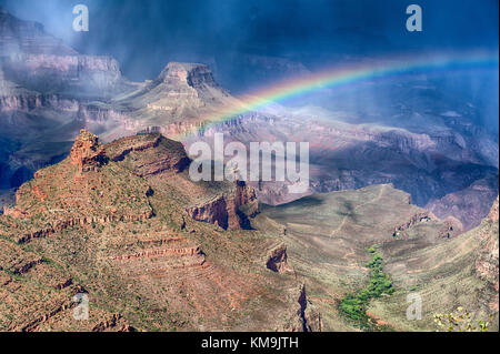 Grand Canyon National Park Arizona, changing weather with sudden squalls and rain, forming a rainbow across the - Stock Image