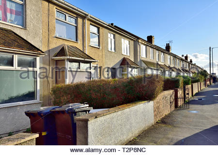 Street of terraced suburban houses in Filton, suburb of Bristol in South Gloucestershire, England, UK - Stock Image