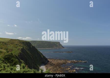 View from the Crovie Cliffs towards Gardenstown, Aberdeenshire, Scotland, UK. - Stock Image