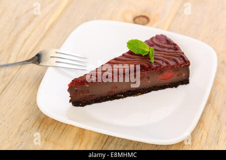 A slice of chocolate raspberry cheesecake - Stock Image