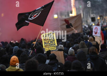 Vienna, Austria. 13th Jan, 2018. protesters waving flags and  carrying a sign during an anti-government demonstration. - Stock Image