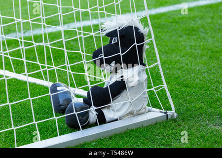 sports, football, Bundesliga, 2018/2019, Borussia Moenchengladbach, Stadium Borussia Park, memorabilia, mascot Juenter of Borussia Moenchengladbach as a rag doll sits on the grass field in the goal net, DFL REGULATIONS PROHIBIT ANY USE OF PHOTOGRAPHS AS IMAGE SEQUENCES AND/OR QUASI-VIDEO - Stock Image