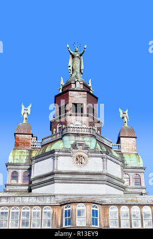 Magnificent facade of the historic Notre-Dame-de-Bon-Secours that features a statue of the Virgin Mary with her arms open wide towards the Saint Lawre - Stock Image