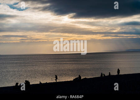 Budleigh Salterton, Devon, 1st Jan 19, Families enjot the late afternoon ion the beach at Budleigh Salterton, Devon. Photo Central / Alamy Live News - Stock Image