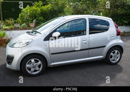 French Peugeot 107 mini-car side view showing two-door design - Stock Image