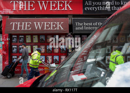 Workmen to and fro on the corner of Berwick and Broadwick Streets on 7th March 2019, in London, England. - Stock Image