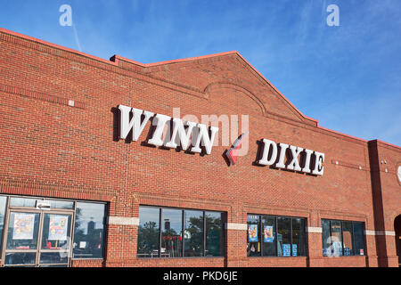 Winn Dixie front exterior entrance to the supermarket or grocery store with the corporate logo sign in Montgomery Alabama USA. - Stock Image