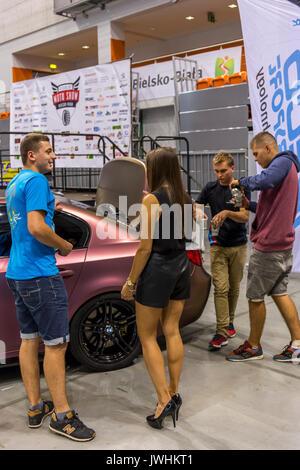 Bielsko-Biala, Poland. 12th Aug, 2017. International automotive trade fairs - MotoShow Bielsko-Biala. People talking with a hostess. Credit: Lukasz Obermann/Alamy Live News - Stock Image