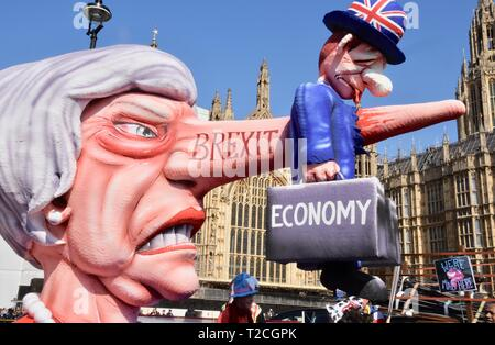 1st Apr 2019. An Effigy of Prime Minster Theresa May  ' She nose it's a disaster' The effigy was originally created for the Dusseldorf ``carnival in Germany. It was a key feature of the People's Vote March on 23.03.2019. Pro and Anti Brexit Protests, Houses of Parliament, Westminster, London. UK Credit: michael melia/Alamy Live News - Stock Image