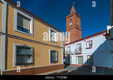 Urban view with the church tower. Alosno. Huelva province. Region of Andalusia. Spain. Europe - Stock Image