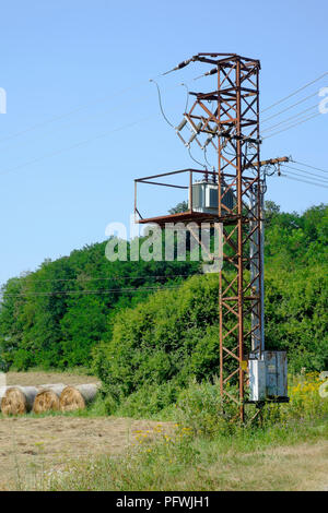 old rusty electricity pylon standing in rural countryside zala county hungary - Stock Image