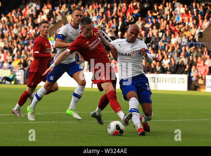 Birkenhead, Wirral, UK. 11th July 2019; Prenton Park, Tranmere, England; Pre-season friendly football, Tranmere versus Liverpool; Jake Caprice tackles Ryan Kent of Liverpool as he attempts a shot at goal Credit: Action Plus Sports Images/Alamy Live News - Stock Image