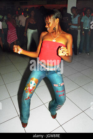 Local youths dance at Kingston's hottest Dancehall nightclub ? Club Quad?. Kingston, Jamaica, Eastern Caribbean. - Stock Image