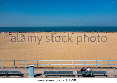 Scheveningen, The Hague, Netherlands. People relaxing on the North Sea Shore Beach on one of the first warm and sunny days of the year (2018). An elde - Stock Image