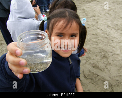 Girl showing jar on field trip - Stock Image