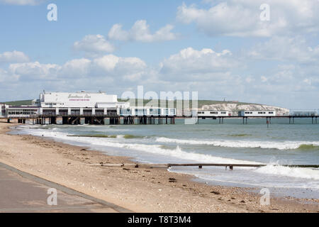 Sandown Pier with Culver Down in the background as seen from the walk along the seafront from Shanklin to Sandown - Stock Image