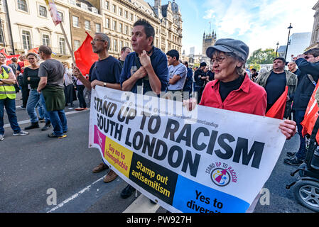 London, UK. 13th October 2018.    Poeple hold the Stand Up To Racism South London banner at the rally in London to oppose racism  and fascism close to where the racist, Islamophobic DFLA were ending their march on Whitehall bringing together various groups to stand in solidarity with the communities the DFLA attacks. The event was organised by Stand Up To Racism and Unite Against Fascism. Peter Marshall/Alamy Live News - Stock Image