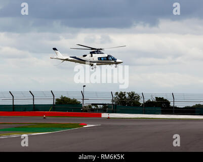 Close-up of a  privately owned Augusta Westland AW109 landing trackside, during the 2017 Silverstone Classic - Stock Image