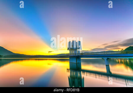 Architectural beauty hydroelectric power with long rays sunset sky radiating beautifully colorful atmosphere as warm to admire - Stock Image