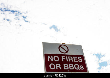 No fires or BBQs sign, no fires sign, copy space, no BBQ's sign, park rules, warning, warning sign, signs, danger, no fire, fire, no, fires, - Stock Image