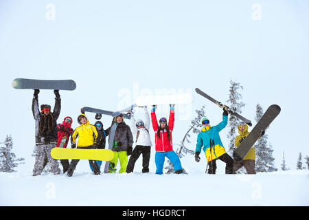 friends team group skiers snowboarders - Stock Image