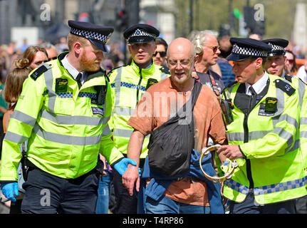 London, UK. 19th Apr 2019. Environmental campaign group Extinction Rebellion continue to stop occupy several locations around the city, to demand that the Government take emergency action on the climate and ecological crisis. Police make arrests in Parliament Square Credit: PjrFoto/Alamy Live News - Stock Image