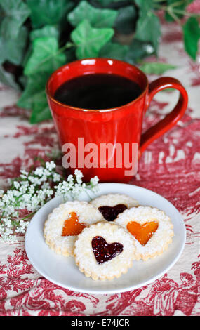 Coffee and Linzer cookies - Stock Image
