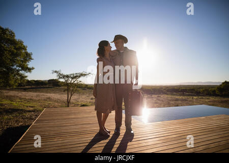 Couple standing together on wooden plank - Stock Image