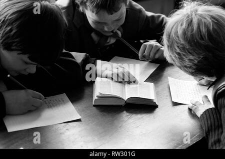 Education: Lack of text books in the early 1980's led to school children having to share books. Books were repaired many times and were only replaced when they could not be read. March 1981 PM 81-01143-004 - Stock Image